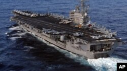 U.S. Nimitz-class aircraft carrier, USS Ronald Reagan, sails in the Pacific Ocean March 12, 2011 to Japan to render humanitarian assistance and disaster relief. (File photo - US Navy - Dylan McCord)