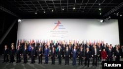 Leaders pose for a group photo during the Asia-Europe summit in Milan, Italy, October 16, 2014.