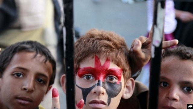 Boys take part in a rally to celebrate the departure of Yemen's President Ali Abdullah Saleh to Saudi Arabia for medical treatment in Sanaa, June 5, 2011