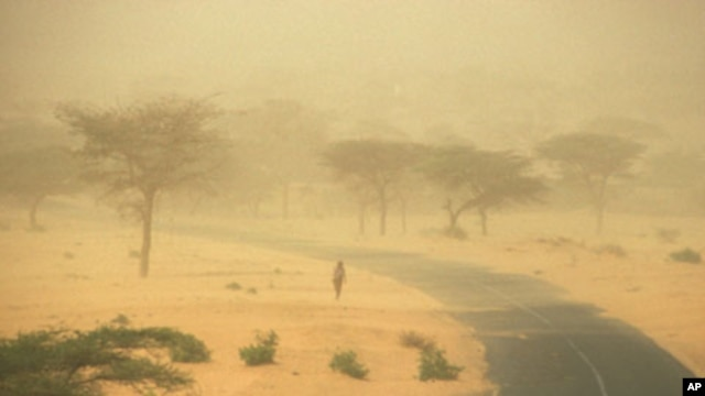 FILE - Through the 1980s, rainfall in the African Sahel declined more than anywhere else in the world, causing increased aridity, as evidenced by this dust storm in Senegal.