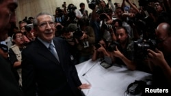 FILE - Former Guatemalan dictator Efrain Rios Montt arrives at the Supreme Court of Justice for his sentencing in Guatemala City, May 10, 2013.