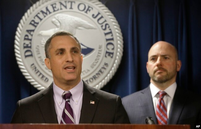 FBI Special Agent in Charge Boston Division Joseph Bonavolonta, left, and U.S. Attorney for District of Massachusetts Andrew Lelling, right, face reporters as they announce indictments at a news conference, March 12, 2019.