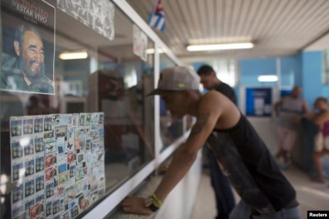 A picture of former Cuban President Fidel Castro is seen inside a post office in Havana, Dec. 11, 2015.
