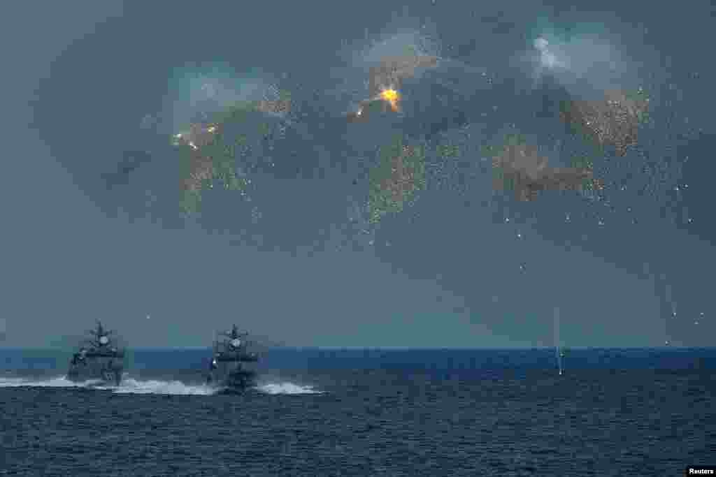 The Japanese Maritime Self-Defense Force (JMSDF) fires decoys during a fleet review at Sagami Bay, off Yokosuka, south of Tokyo.