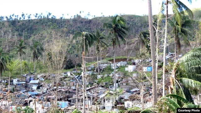 Scientists predict more extreme weather events like Typhoon Bopha which struck the Philippines in 2012, devastating homes. (OCHA)