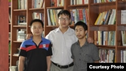 FILE - Beijing lawyer Zhang Kai is pictured with Wu Liangjie (L) and Deng Jiyuan (R), who are not otherwise identified in this courtesy image.