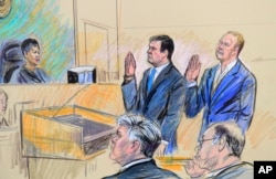 A court artist drawing shows President Donald Trump's former campaign chairman, Paul Manafort, center standing and Manafort's business associate, Rick Gates, in federal court in Washington, Oct. 30, 2017, before U.S. Magistrate Judge Deborah A. Robinson.