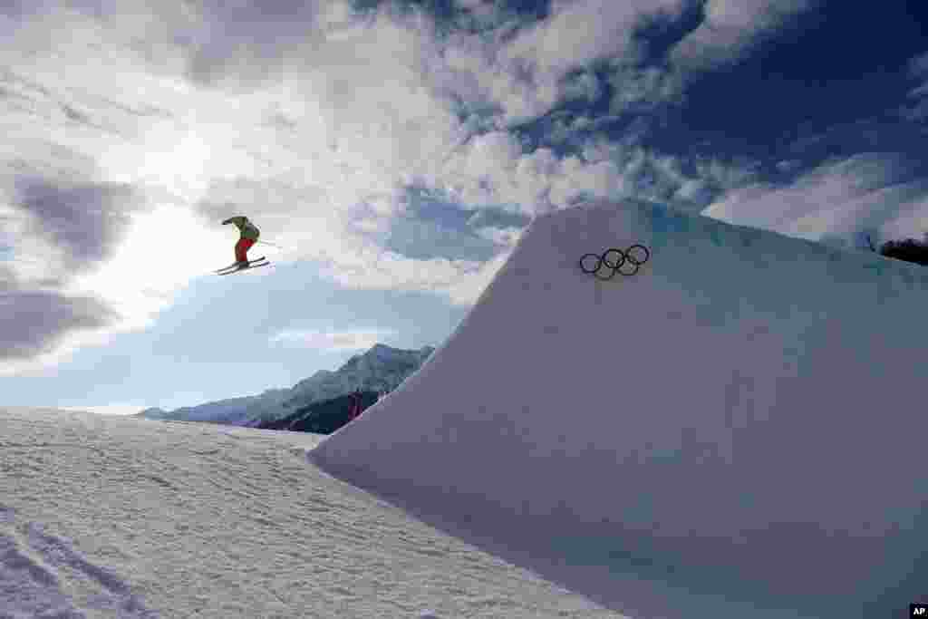 Chile's Dominique Ohaco takes a jump during freestyle training in Krasnaya Polyana, Russia, Feb. 10, 2014.