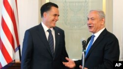 FILE - Israel's Prime Minister Benjamin Netanyahu with Mitt Romney, in Jerusalem, July 29, 2012.