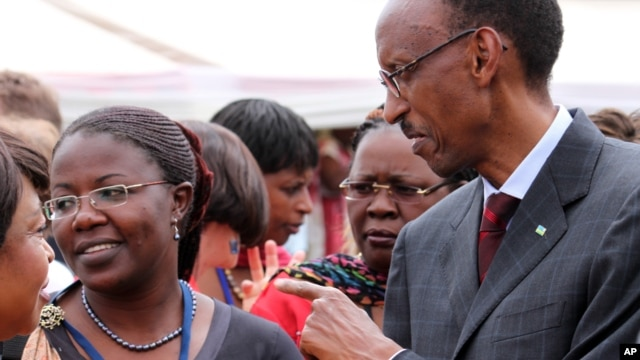 FILE  - Rwandan President Paul Kagame meets with participants at a conference on the role of women at the nation's parliament, in Kigali, May 2010.
