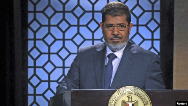 Egypt's President-elect Mohamed Morsi speaks during his first televised address to the nation at the Egyptian Television headquarters, Cairo June 24, 2012.