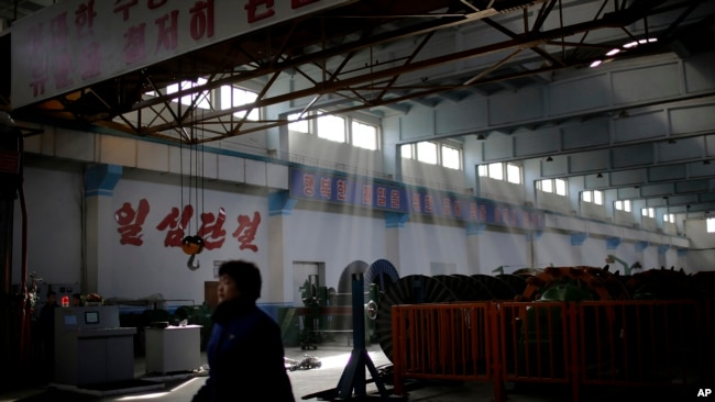 FILE - A North Korean factory worker walks through a processing hall at the Pyongyang 326 Electric Wire Factory pull Tuesday, Jan. 10, 2017, in Pyongyang, North Korea.