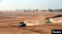 库尔德敢死军在巴什卡附近与伊斯兰国武装战斗