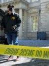 USA, Washington. An FBI agent mans his post as the U.S. law enforcement agency conducted a raid at Russian oligarch Oleg Deripaska's