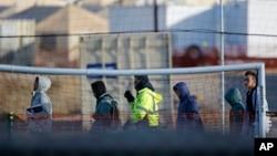 Teen migrants walk in line inside the Tornillo detention camp in Tornillo, Texas, Dec. 13, 2018.
