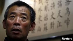 ນາຍ Cheng Guangfu ອ້າຍຂອງນາຍ Chen Guangcheng ນັກເຄຶ່ອນໄຫວຕາບອດ