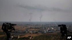 20일 터키군의 중점 공세지역인 시리아 라스알아인 마을에서 연기가 치솟고 있다.