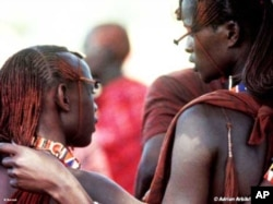 Two young Maasai men in conversation
