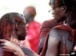 Two young Maasai men in conversation
