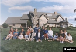 FILE PHOTO 24AUG86 - Portrait of the Bush family sitting in front of their home in Kennebunkport, Maine.
