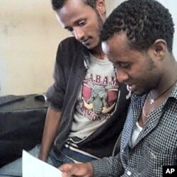 Yusuf Tamiru checks over a printout of the confirmation that he has registered for the DV2013 diversity visa lottery, Addis Ababa, October 31, 2011.