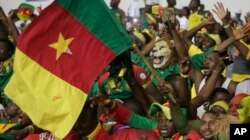 FILE - Cameroon supporters chants ahead of soccer match against Guinea Bissau during the African Cup of Nations Group A soccer match between Cameroon and Guinea Bissau at the Stade de l'Amitie, in Libreville, Gabon, Jan. 18, 2017.