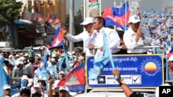 Opposition party Cambodia National Rescue Party (CNRP) President Kem Sokha greets his supporters from a truck as he leads a rally during the last day of campaigning ahead of communal elections in Phnom Penh, Cambodia, Friday, June 2, 2017.