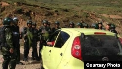 Chinese security forces block Tibetans from ascending hill to mark the Dalai Lama's birthday on July 6, 2013.