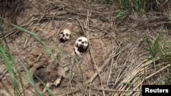FILE - Human skulls are seen on the roadside in Tshienke near Kananga, the capital of Kasai-central province of the Democratic Republic of Congo, March 12, 2017.