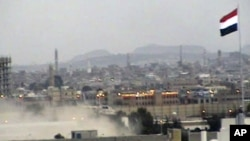 In this image taken from TV, showing Yemeni army helicopter emerging from the dust as it airlifts U.S. and other ambassadors out of a besieged embassy in Sanaa, Yemen, to the Presidential Palace to witness ruling party leaders signing an agreement for the