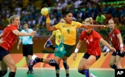 Brazil's Ana Paula Belo, center, scores a goal past Norway's Marit Malm Frafjord, right, during the women's preliminary handball match between Norway and Brazil at the 2016 Summer Olympics in Rio de Janeiro, Brazil, Aug. 6, 2016.