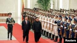 Çin Devlet Başkanı Xi Jinping ve Kuzey Kore Lideri Kim Jong Un (Arşiv)