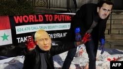 Aktivisti za ljudska prava protestovali su juče ispred sedišta UN koristeći maske Bašara al-Asada i Vladimira Putina