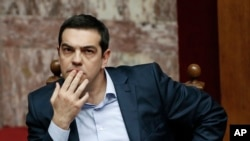 FILE - Greece's Prime Minister Alexis Tsipras gestures during a parliamentary session in Athens, March 30, 2015.