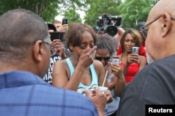 Diamond Reynolds weeps after she recounts the incidents that led to the fatal shooting of her boyfriend Philando Castile by Minneapolis area police during a traffic stop on Wednesday.