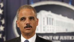 Attorney General Eric Holder speaks during a news conference at the Justice Department in Washington, Tuesday, Oct. 11, 2011