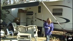 Tammy Renault, her husband and four of their five sons now live in a donated travel-trailer.