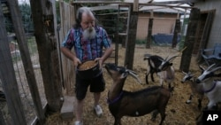 Bill Hendren tends goats and performs other farm chores in exchange for a year's free rent in rural Otero County, Colorado. He has faced increasing hardship.
