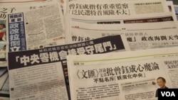 香港媒体报道立法会主席曾钰成有关普选的谈话 (美国之音海彦拍摄)