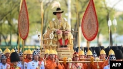 Thailand's King Maha Vajiralongkorn is carried in a golden palanquin during the coronation procession in Bangkok, May 5, 2019.
