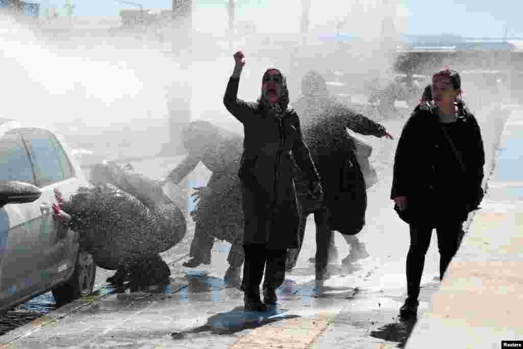 Turkish riot police use a water cannon to disperse demonstrators as they protest the death of a Kurdish inmate, in Diyarbakir.