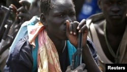 Rebel fighters listen to their commander in rebel-controlled territory in Upper Nile State, Feb. 15, 2014. Fresh fighting broke out there on Thursday, March 5, 2015.