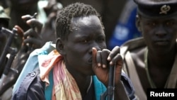 A rebel fighter listens to his commander in Upper Nile state in February 2014.