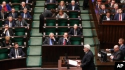 Poland's Foreign Minister Witold Waszczykowski bottom, standing) delivers an annual policy speech in parliament in Warsaw, Poland, Feb. 9, 2017.