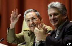 President Raul Castro waves during a twice-annual legislative session at the National Assembly in Havana, Dec. 19, 2014.