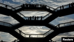 People tour the inside 'The Vessel,' a large public art sculpture made up of 155 flights of stairs at the Hudson Yards development, a residential, commercial, and retail space on Manhattan's West side in New York City, New York, U.S., May 26, 2019.