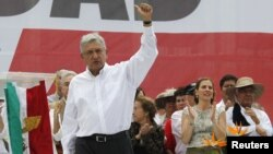 Election runner-up Andres Manuel Lopez Obrador waves to supporters