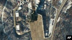This satellite image provided by DigitalGlobe shows the Sohae Satellite Launching Station in Tongchang-ri, North Korea, 54 minutes after a long-range Unha-3 rocket was successfully launched, Wednesday, Dec. 12, 2012.