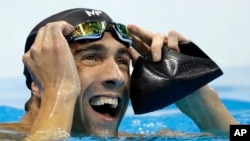 "FILE - United States' Michael Phelps reacts after the men's 100-meter butterfly final during the swimming competitions at the 2016 Summer Olympics, Friday, Aug. 12, 2016, in Rio de Janeiro, Brazil. Phelps will ""race"" a shark during Shark Week."