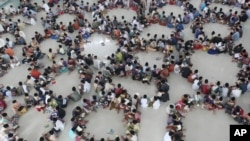 Students sit in circles during a Quran recital class on the first day of the holy fasting month of Ramadan at a school in Medan, North Sumatra, Indonesia, June 2016. (AP Photo/Binsar Bakkara)